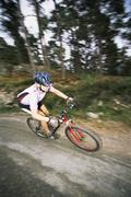 Stock Photo of Man outdoors on trails riding bicycle (selective focus)