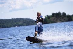 Woman waterskiing - stock photo