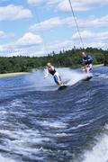 2 people waterskiing Stock Photos