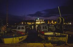 Boat colorful harbour night exposure boats rovin Stock Photos
