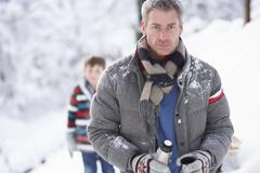 Stock Photo of family stopping for hot drink and snack on walk through snowy landscape