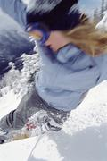 Snowboarder coming down snowy hill (selective focus) - stock photo