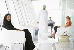 Airline passengers waiting in departure gate Stock Photos