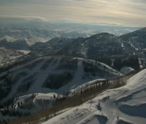 aerial shot of ski resort, mountains, and town - stock footage