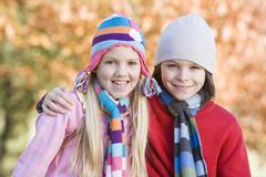 Two young children outdoors in park smiling (selective focus) Stock Photos