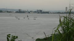 Grasses rack focus to boats on the Congo River Stock Footage