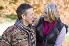 Couple outdoors in park bonding and smiling (selective focus) Stock Photos