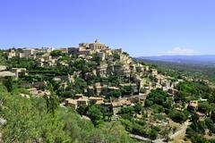 Gordes medieval village on rock hill. luberon, provence, france. Stock Photos