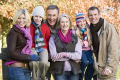Family outdoors at park smiling (selective focus) - stock photo