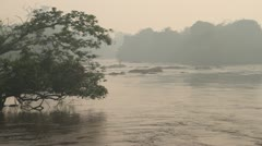 Jungle river with haze and fishermen Stock Footage
