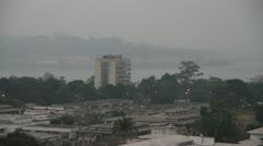 Hazy city with radio tower Stock Footage