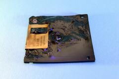 computer internet technology broadband broken cd - stock photo