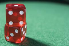 Dice sitting on a poker table (close up/selective focus) Stock Photos