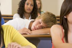 Student in class sleeping (selective focus) Stock Photos