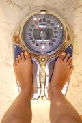 Body part fat health kilo overweight pound scale Stock Photos