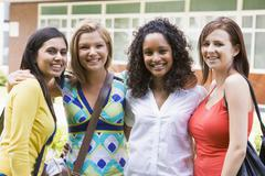 Group of students outdoors looking at camera smiling Stock Photos