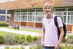 Student standing outdoors smiling Stock Photos