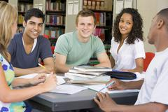 Five people in library studying (selective focus) - stock photo