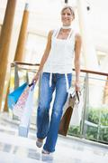 Woman with shopping bags at a shopping mall - stock photo