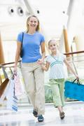 Mother and young daughter at a shopping mall - stock photo