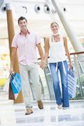 Young couple at a shopping mall - stock photo