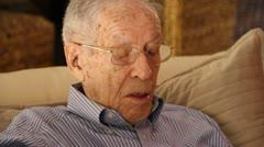 CU Elderly man watching TV Stock Footage