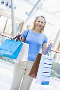 Woman with shopping bags at a shopping mall Stock Photos