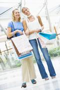 Two women at a shopping mall - stock photo