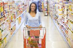 Woman shopping at a grocery store Stock Photos