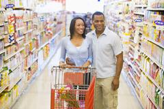 Young couple shopping at a grocery store Stock Photos