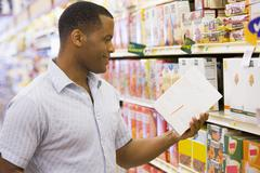 Man shopping at grocery store Stock Photos