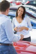 Woman shopping for a new car Stock Photos