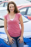 Woman shopping for a new car - stock photo
