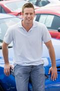 Man shopping for a new car - stock photo