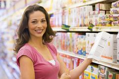 Woman shopping at a grocery store - stock photo