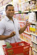 Man shopping at grocery store - stock photo
