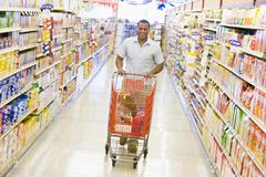 Man shopping at a grocery store Stock Photos
