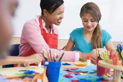 Teacher and student in art class (selective focus) - stock photo