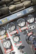 Fire hoses and pressure gauges in fire engine - stock photo