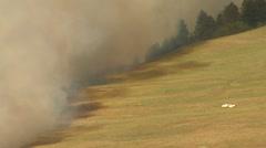 Firetruck backs down road toward fire Stock Footage