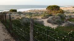 Old fence near Ocean Beach Stock Footage