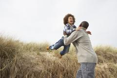 Father and son having fun in sand dunes Stock Photos