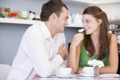 Young couple having tea in a cafeteria Stock Photos