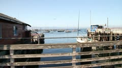 boats and pier on fisherman's wharf in Monterey California - stock footage