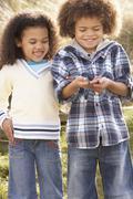 children holding worm outdoors - stock photo