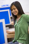 Female student in computer class Stock Photos