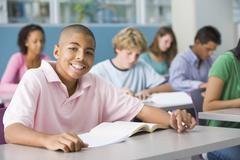 Students studying in geography class - stock photo