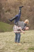 portrait of energetic young couple having fun - stock photo