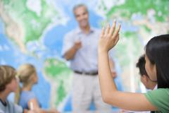 Students answering questions in geography class Stock Photos