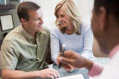 Couple in consultation at IVF clinic (selective focus) - stock photo
